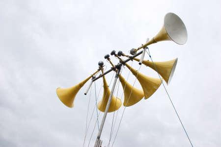 aural: large yellow loudspeaker system