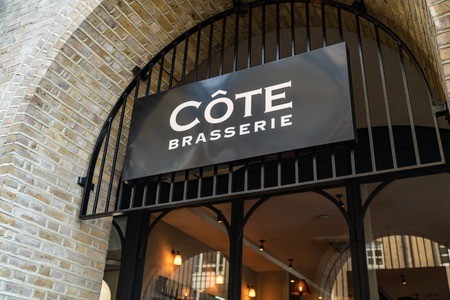 LONDON, UK - APRIL 1, 2019: A sign for a Cote Brasserie Restaurant in central London Editöryel