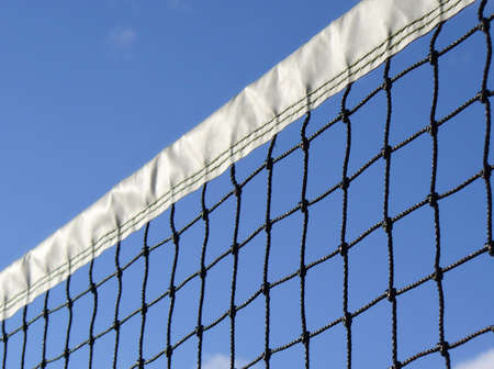 seem: looking up at a tennis net from a low angle on a blue sky summer day Stock Photo