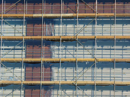 Scaffolding on a building site with red bricks photo