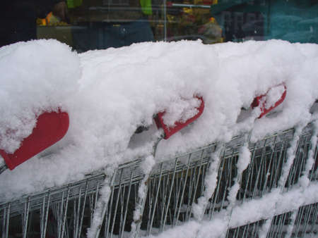 settled: Thick heavy snow settled on a shopping trolley