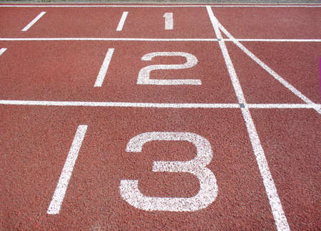 lanes with numbers on an athletics track photo