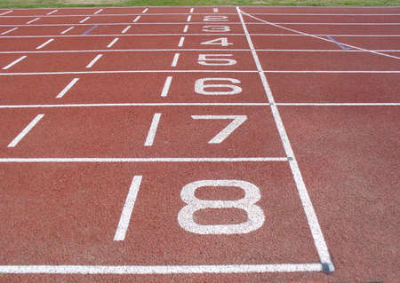 lanes with numbers one to eight on an athletics track photo