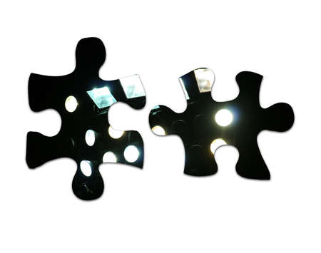 jig: two joining floodlight jigsaw pieces which link together Stock Photo