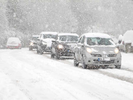 snowing: cars driving in heavy snow in england                                Stock Photo