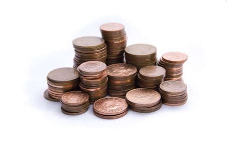look after: Stacks of pennys isolated on a white background.  Look after the pennys and the pounds will look after themselves. Stock Photo