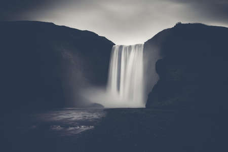 Powerful waterfall - The famous Skogafoss in Iceland, monochrome with strong contrast.