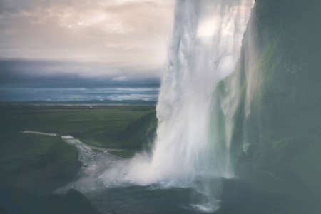 Behind the waterfall - A remarkable waterfall in Iceland with rural scenery in the down. Stock Photo - 51566535