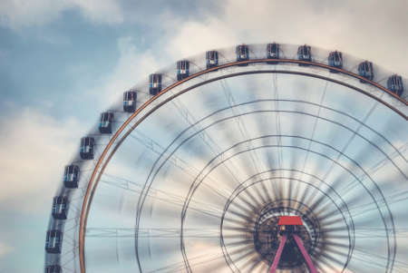 Fun on the ferries wheel - Imagine to ride on a ferries wheel that is turning faster and faster ... Stock Photo
