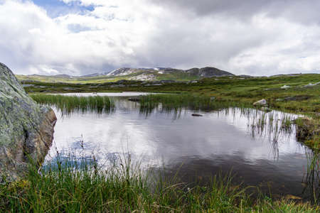 mirroring water Norway mountain clouds sky Stock Photo