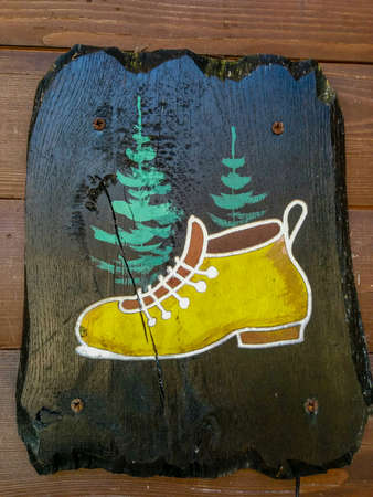 Hiking sign toilet mens shoe Stock Photo