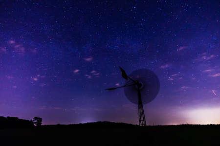 beautiful night photo of wind generators and stars with abstract lighting Archivio Fotografico - 117490872