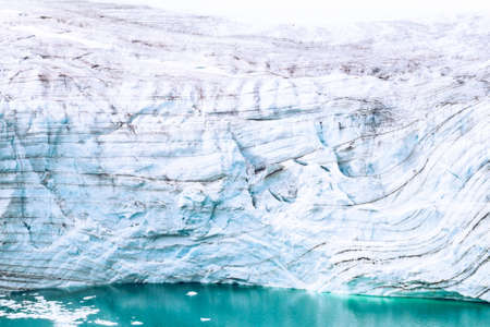Glaciers of polar caps of the Earth. Ice Wall of sheet glacier (Ice front, zone of ablation), glaciology, glaciers study, climate change, ice melting. Franz Joseph Land, Rudolf island Stock Photo