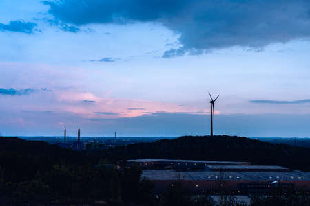 power generator wind turbines on the mountain location at Huay Bong, Dan Khun tod, Nakhonratchasima. Sunrise is falling in the evening.