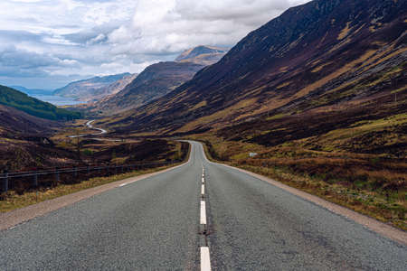 road valley scotland mountains clouds street
