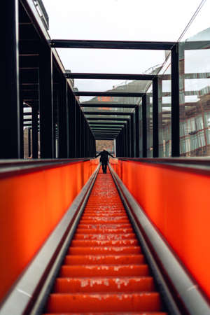 Modern stairs with black boarding and orange lit converging lines in Zollverein