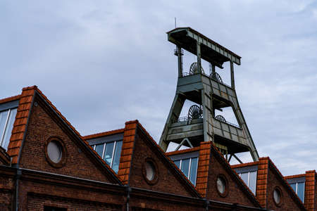 View of the disused coal mine Ewald in the Ruhr area in Germany with houses in front