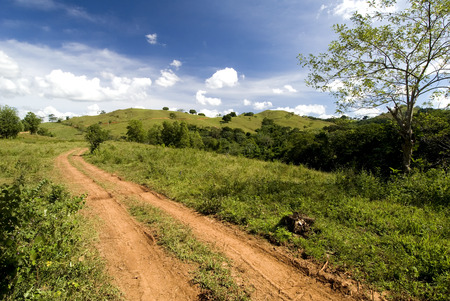 dirt: This image shows a red dirt road in the Domonican Republic Stock Photo