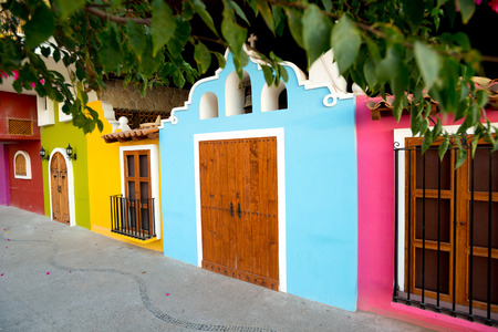 This image Bright facades of traditional Mexican architecture, in Puerto Vallarta