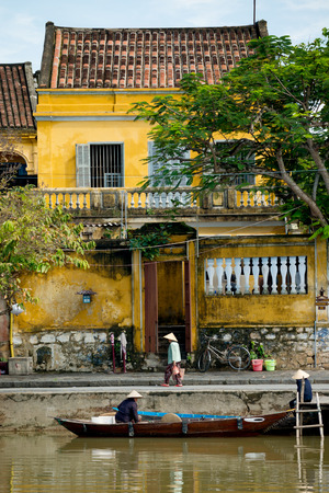 exceptionally: HOI AN, VIETNAM - OCTOBER 25, 2014. Hoi An Ancient Town is a UNESCO, World Heritage Site, and an exceptionally well-preserved example of a South-East Asian trading port.