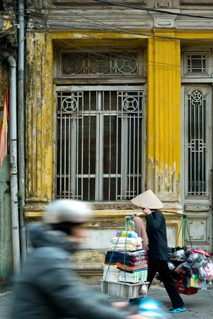 This image shows a street scene in Hanoi, Vietnam