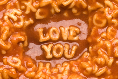 This image shows a message spelled out in pasta photo