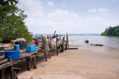 pulau: This image shows a Beach and wooden jetty on Pulau Ubin, Singapore