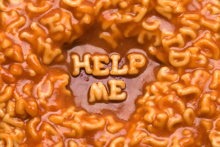 This image shows a message spelled out in pasta