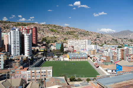 largest: LA PAZ, BOLIVIA – MAY 10: People play footballsoccer in La Paz, Bolivias largest city on May 10, 2012