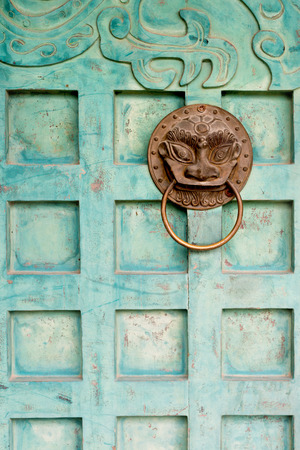 mage: This mage shows a guardian door detail in Hanoi, Vietnam Stock Photo