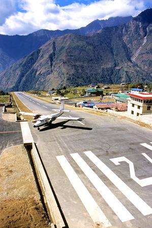 airstrip: The image shows the mountain top Lukla airstrip. Stock Photo