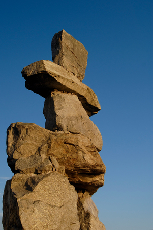 inukshuk: This image shows an Inukshuk  in English Bay, Vancouver, Canada