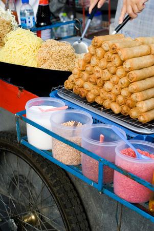 vendor: This image shows a Bangkok Food Vendor Stock Photo