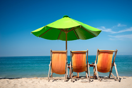 beach chairs: This image shows a beach scene in  Puerto Vallarta, Jalisco, Mexico