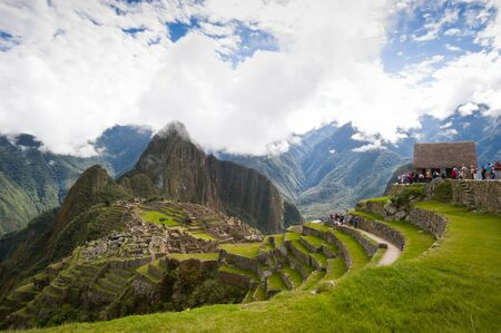 funerary: Hordes of tourists gather on the funerary plain to view  Manchu Picchu, Peru