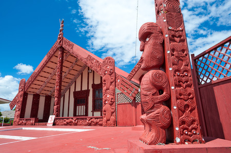 This image shows a maori marae (meeting house and meeting ground) Stock Photo