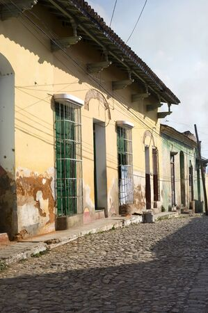 stoned: This image shows the cobble stoned streets and colorful architecture of Trinidad, Cuba Stock Photo