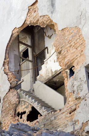 exposed: This images hows an exposed stairway ina  crumbling building in Havana, Cuba