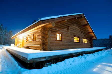 log cabin in snow: This image shows a log cabin in the snow, Canada Editorial