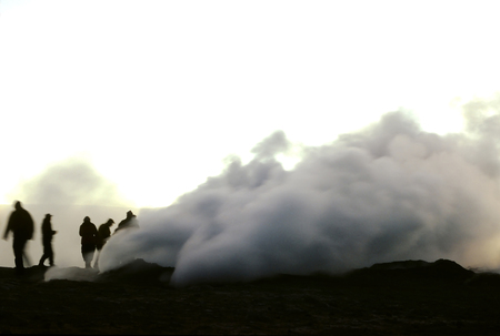 spurt: This image was shot at the Sol de Manana geysers in Bolivia at Sunrise. This image was tripoded with a long exposure – the human figures and steam contain motion blur