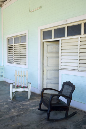 This image shows a couple chairs on a porch in Vinales, Cuba photo