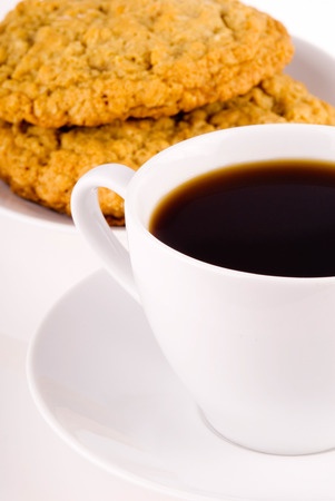 distinctive flavor: This image shows a plate of Cookies and Coffee Stock Photo