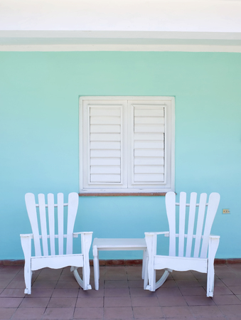 This image shows a porch scene in Vinales, Cuba photo