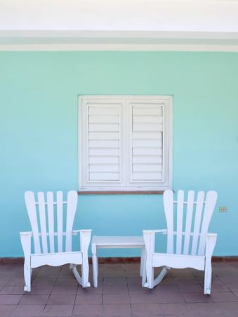 porch scene: This image shows a porch scene in Vinales, Cuba Stock Photo
