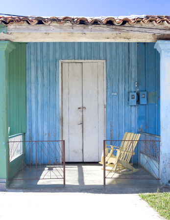 THis image shows a colourful porch in Vinales, Cuba photo