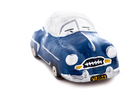 communism: This image shows a figurine of an old car often seen in Havana, Cuba