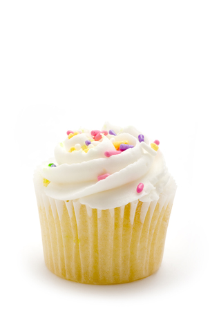 vanilla cupcake: This image shows a  delicious vanilla  cupcake Stock Photo