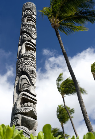 This image shows a carved tiki pole in Hawaii