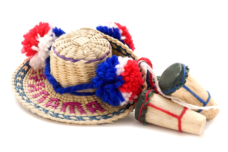 pom: This image shows a Panama hat souvenir with pom poms in Panamas colors and toy drums.