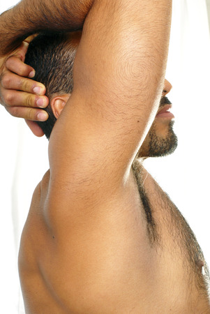 hairy chest: This image shows an abstract portrait of a shirtless muscular Hispanic man.